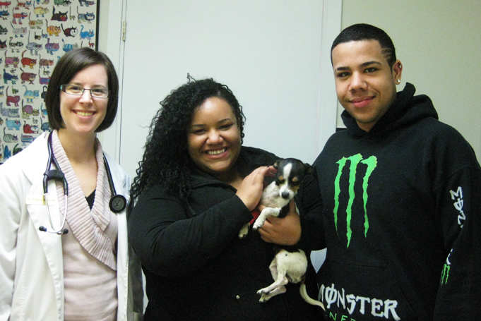 Tequila the Chihuahua with owners and North Town Veterinary hospital veterinarian